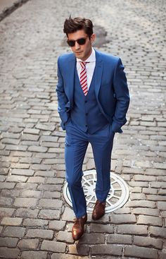 Love the bold blue tux and red tie