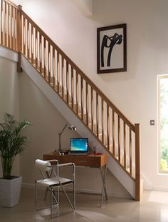 Contemporary wood staircase hand finished by our in-house French polishers.