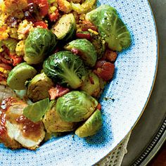 Brussels Sprouts w/Applewood Bacon 2 lbs fresh Brussels sprouts halved,5 applewood-smoked bacon diced, 2 T butter 1/3 C pckd Lt Br sugar 1/4 t cinnamon, 1/8 t fresh gr nutmeg Cook sprouts in boiling water 4 min, drain. Put in ice water, drain. Cook bacon in skillet med heat 10 min/until crisp; drain on paper towels, reserve 1 T. drippings. Melt butter in drippings med-high heat; add br sugar, cinnamon, nutmeg. Cook 1 min/until sugar is melted/thickens. Add sprouts cook stirring often 10-12…