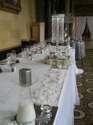 Crystal Chandelier Table Centres, winter wonderland themed table centres, winter themed events, crystal columns for winter themed weddings. top table designs