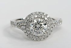 Here's a conversation-starting ring with pave diamonds and a double halo design around the center diamond.