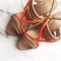 """Gwen Stefani GX Sandal Brand new. Never worn. Beautiful Summer sandals that will make a splash wherever you go. Gorgeous nude with neon orange detailed straps. Heel is low about 2-2.5"""". Size 6. Can fit an ideal 5.5. Size 6 feet will still fit...its just a perfect fit 6 from heel to toe. No trade. All images are my own. GX by Gwen Stefani Shoes Sandals"""