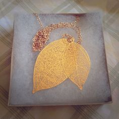 NWT Delicate leaf necklace. Beautiful double leaf necklace. Very delicate & versatile gold accessory. New with tags. Jewelry Necklaces