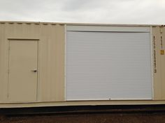 Man door and Roll Shutter installed in side of 40' shipping container by SeaBox depot