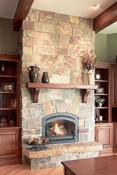 The stonework in this fireplace gives you a rustic warm look with a modern twist. an electric fireplace. by ursula - Fireplace Today Home Fireplace, Fireplace Remodel, Fireplace Ideas, Fireplace Stone, Simple Fireplace, Fireplace Mantels, Wood Mantle, Mantel Ideas, Fireplace Makeovers