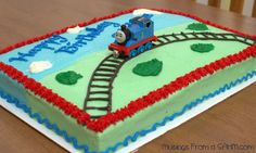 Joshua wanted a Thomas the Tank Engine cake for his 3rd birthday, so this is what I made. I found the original idea from Pinterest. (Of course!)