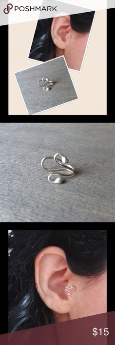 Travis Cuff - 999 Fine Silver A cute, trendy little swirly ball End Travis Cuff made of fine .999 Sterling silver. ⭐️NOTE⭐️ Fine 999 Sterling silver is 99.9% pure silver while 925 Sterling silver is only 92.5% silver. Completely hypoallergenic and nickel free. Comes gift boxed ready for gift giving. nejd Jewelry Earrings