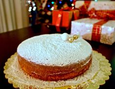 This Lemon flavored Greek New Year's Cake -Vasilopita- made with olive oil instead of butter is light, fluffy and tasty. Vasilopita Cake, New Year's Cake, Hazelnut Cake, Greek Dishes, Specialty Cakes, Cake Tins, Just Desserts, Greek Desserts