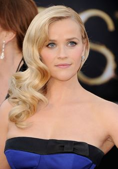 Reese Witherspoon does the old Hollywood thing with sideswept curls