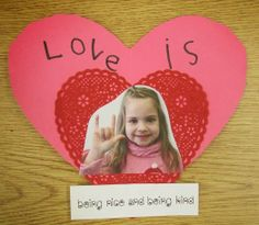 Kindergarten: Holding Hands and Sticking Together Adorable Valentine's bulletin board idea