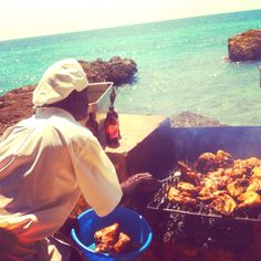 World Famous Mr Lloyd James cooking Jerk Chicken on the BBQ, in Bluefields Bay.