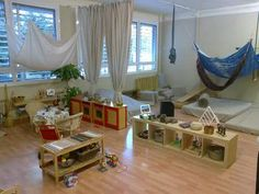 Infant/toddler classroom. Love the soft area and low shelves!