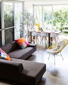 Open plan living area. Marimekko and Spacecraft Cushions, yellow Acapulco chair. #KBHomePhoenix