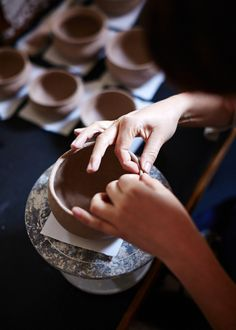 quincewithsugar:  The Design Files: Hannah pinching a new vessel into shape.  Photo - Sean Fennessy