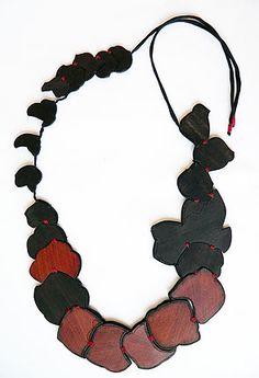 Flóra Vági | leaves necklace - made of ebony, padauk, silk  floravagi.net
