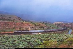 Skirting a late spring rainstorm, Amtrak's westbound California Zephyr climbs the Wasatch range at Colton, Utah.