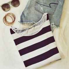 J. Crew jersey striped top Two tone stripes and boat neck styling make this t-shirt a preppy classic! Made of soft jersey with navy and plum stripes, this top pairs with shorts, boyfriend jeans or even your favorite A-line skirt. Celebrate spring in style! In excellent used condition. J. Crew Tops Tees - Long Sleeve