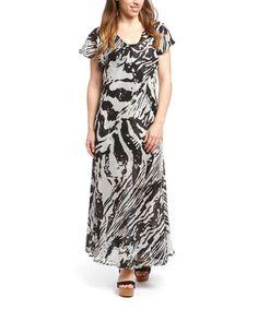 Look at this #zulilyfind! Black & White Zebra Floral Reversible V-Neck Dress - Plus by Ash & Sara #zulilyfinds