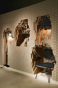 A modular wall made from 10,000 paper pipes that encapsulates furniture by architectyoshimasa tsutsumi