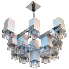 1970s Cubic Chandelier in Brushed Steel by Gaetano Sciolari | From a unique collection of antique and modern chandeliers and pendants at https://www.1stdibs.com/furniture/lighting/chandeliers-pendant-lights/