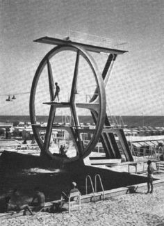 Diving board at Kursaal swimming pool, Ostia, Italy (circa A distinctive wheel-shaped diving structure designed by Pier Luigi Nervi, and built in Architecture Today, Concrete Architecture, Swimming Diving, Swimming Pools, High Diving, Pier Luigi Nervi, Backyard Trampoline, Scuba Diving Equipment, Diving Board