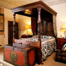 Medieval bedroom with awesome painted chest. Charles I Oak Tester Bed. With hand-carved decoration to head and foot posts.