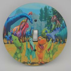 DINOSAUR TRAIN Light switch Cover 5 Inch Round (12.5 cms) Switch plate Switchplate by Character Creations. $12.00. NOT a Sticker.  Image is heat sealed into the switchplate, therefore is completely washable.. Hardboard with Beautiful Glossy Finish. Large 5 inches (12.5 cms) Lightswitch Cover. Beautifully finishes off any room. Dinosaur Train Design. This is a fantastic addition to any bedroom, recroom or playroom and is made from hardboard, with a glossy front.  This...