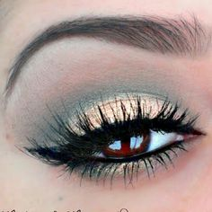 Channel your inner vamp with this smokey eye makeup, which works for both daytime and nighttime. False eyelashes and mascara make this look even more dramatic.