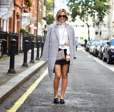 High neck sweater with a oversized coat and loafers