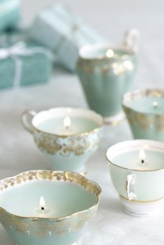 Delicate Robin's egg blue and gold teacups used for candle holders.