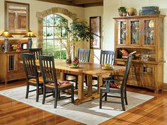 Rustic Mission 7-pc. Dining Set - Gather the family together with this spacious table, 4 side chairs, and 2 armchairs. It has a rustic, yet elegant look. The multi-colored solid oak and veneers, plus the detailing of the wood, make this a stylish and versatile piece. #steinhafels
