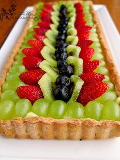 Beautiful fruit flan tart with sweet shortbread crust