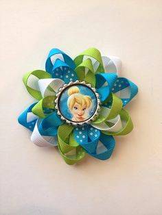 Tinker Bell Hair Bow. Disney Bottle Cap and Tinker Bell and Friends Images on Etsy, $5.00