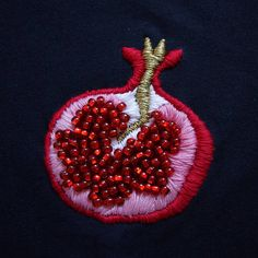 ∙ Hand-beaded/embroidered pomegranate design with anchor(cotton) thread and securely-stitched glass(no dye) beads ∙ T-shirt fabric structure: 90% cotton, 10% polyester --- ∙ High quality shirts supplied by Gildan ∙ Pre-shrunk ∙ Machine wash OK ∙ Iron inside out ∙ Do not put in dryer