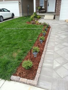 Curb Appeal: brick pavers on end to line a small flower bed along the driveway
