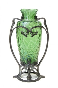 An Art Nouveau Loetz Green Glass and Patinated Metal Mounted Vase, of ovoid form with a ruffled rim, raised on a pierced base with scrolling...