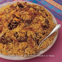 Recipe - Omani Lamb Biryani - Heat 2 tablespoons of ghee in a large pot (reserve 1 tablespoon), add onions and cook until they become golden brown in color. Add garlic and ginger, stir then add water, yogurt, Omani mix spices, dried lime, lamb pieces, MAGGI Chicken Stock cubes and diced tomato.