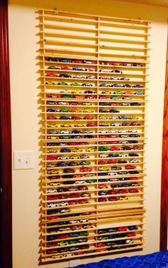 We didn't paint ours but still turned out awesome! The boy loves it & now I don't have to trip over hot wheels cars anymore! Hot Wheels Storage, Hot Wheels Display, Toy Storage, Boys Car Bedroom, Kids Bedroom Storage, Boys Game Room, Boy Room, Kids Room Organization, Hot Wheels Cars