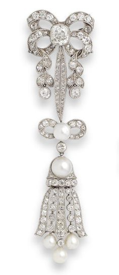 [BROOCH ONLY] A pearl and diamond brooch and earring suite, first half of the 20th century mounted in platinum, diamonds approximately 6.00 carats total, pearls untested, later fittings, length of brooch 8.6cm, cased by J M Stigner, 5 Cheriton Place, Folkestone.