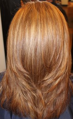 Jennifer Aniston golden blonde done at Rain by Melodi Salon and Spa in Charlotte, NC WITH TOCCO MAGICO
