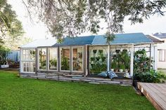Before and after: Old shed to stunning greenhouse | Better Homes and Gardens Deck Planter Boxes, Deck Planters, Build A Greenhouse, Greenhouse Ideas, Rock Retaining Wall, Make A Fire Pit, Rock Garden Design, Backyard Seating, Exotic Plants