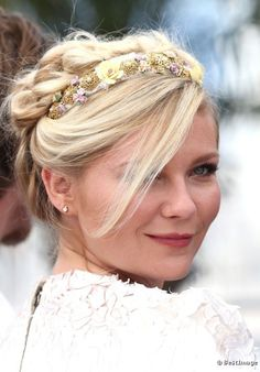 Kirsten Dunst pairs a detailed headband with a braided updo for a very elegant look