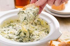 Slow-Cooker Boursin Spinach-Artichoke Dip INGREDIENTS 1 10-oz. box frozen spinach, thawed 2 15-oz. cans artichoke hearts (packed in water), chopped 1 5.2-oz. package Boursin 1 1/2 c. shredded white Cheddar 1/2 c. grated Parmesan 2 cloves Garlic, Chopped 1 tsp. crushed red pepper flakes kosher salt DIRECTIONS In a small slow-cooker, combine spinach, artichokes, Boursin, cheddar, Parmesan, garlic, and crushed red pepper flakes. Season with salt, cover, and cook over high heat, 1 hour.