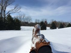 Abigail Brinkman - relaxing in the snow in the front yard - Goodhue, MN #mukluk #stegermukluks