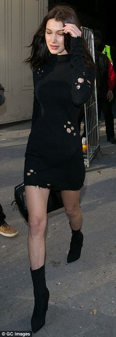 Walk the walk: The 20-year-old supermodel sizzled in the distressed mini-dress that featur...
