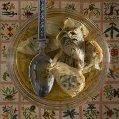 MARINATED ARTICHOKE HEARTS   19-oz. box frozen artichoke hearts,   thawed  1/2 cup extra-virgin olive oil  1 tsp. kosher salt  1/2 tsp. dried thyme  1/2 tsp. dried oregano  1/4 tsp. crushed red chile flakes  2 tbsp. fresh lemon juice