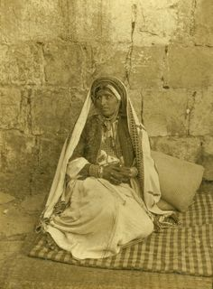 Ramallah - رام الله : RAMALLAH - A woman of Ramallah in traditional local Palestinian costume and ornaments, 1900 -11