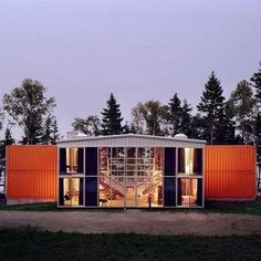 Adam Kalkin created a massive abode that features a dozen shipping containers housed within a large warehouse-like structure.