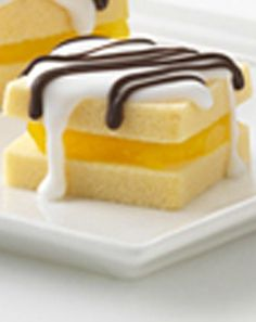 Quick Cake Bites -- Frozen pound cake, lemon-flavor instant pudding and ready-to-spread frosting make this dessert almost as easy to prepare, as they are to disappear.