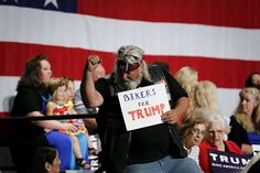 People rally during a campaign event for U.S. Republican presidential candidate Donald Trump in Phoenix, Arizona July 11, 2015. Bikers For Trump Pledge his Protection